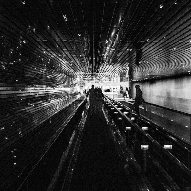 People on walkalator photo by David Yu on Pexels